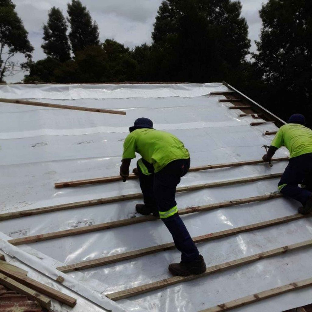 Roofing staff working on roof